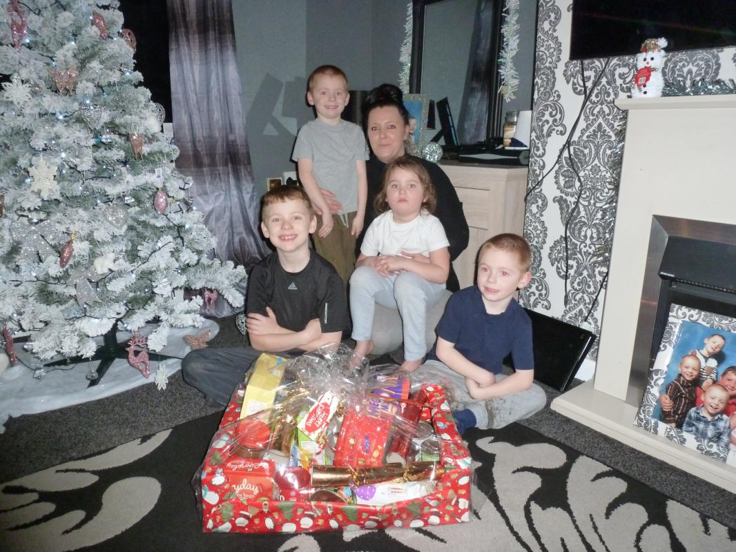 In our photo are Laura and her 4 children, Harley, Connor, Kieran and Kristal, with the hamper that was donated by our generous readers.