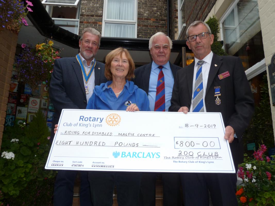 Rosie O'Grady receiving a cheque for £800 from Immediate Past President, Pip Rippengill.  Also in the picture is President Steve Roberts and Geoff Cheney who organises the 200 Club.