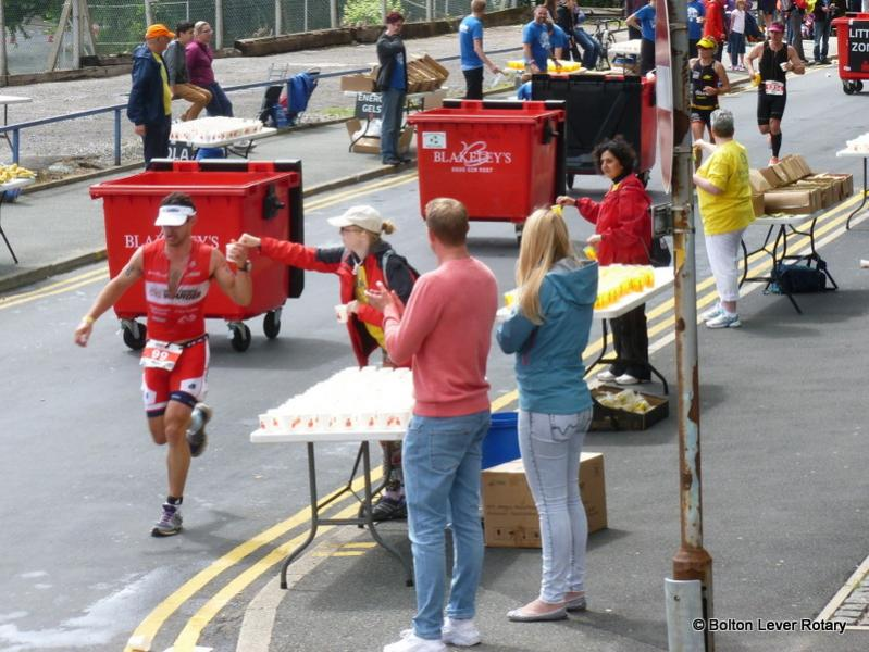 IronmanUK - Rotarians helping the athletes at IronmanUK in Bolton at the four Rotary Feeding Stations