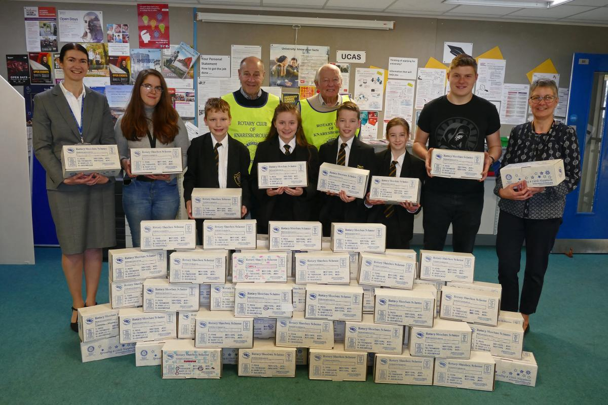 Rotary Shoeboxes will bring joy to many this Christmas - Boroughbridge High School Headteacher Miss K. Stephenson, Sixth Form Mentor Mrs A. Rainbow, Head Boy Callum Anderson, sixth form student & listener Calista Stamos, year 7 pupils Libby Garrington, Rhys Halsall, Mason Hope and Abigail Maw, Rotarian Mik