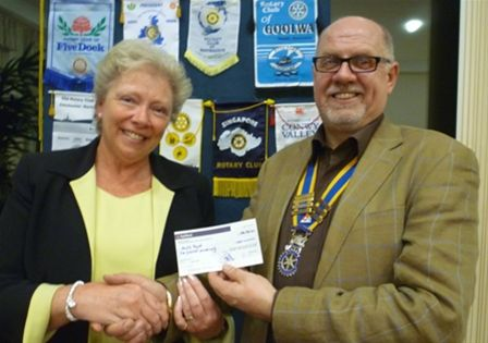 Cheque Presentation in February 2011 - President John presents a cheque to Ann Blight from the Starfish Project Appeal