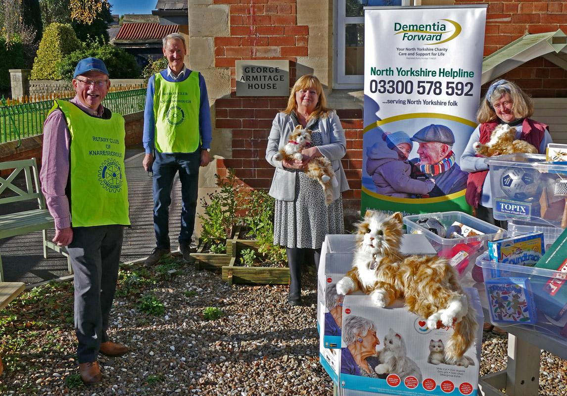 Knaresborough Rotarians Jonathan Beer and John Cook deliver Robotic Companion Cats to Dementia Forward's Chief Executive Jillian Quinn and Activities Co-ordinator Alison Bishop.
