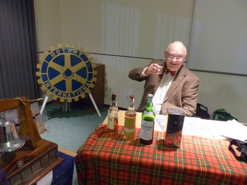 Club Meeting - Burns night after the Haggis Tatties and neaps. - Rtn Eddie with his 4 bottles of Whiskey for tasting after he had told us all about them.
