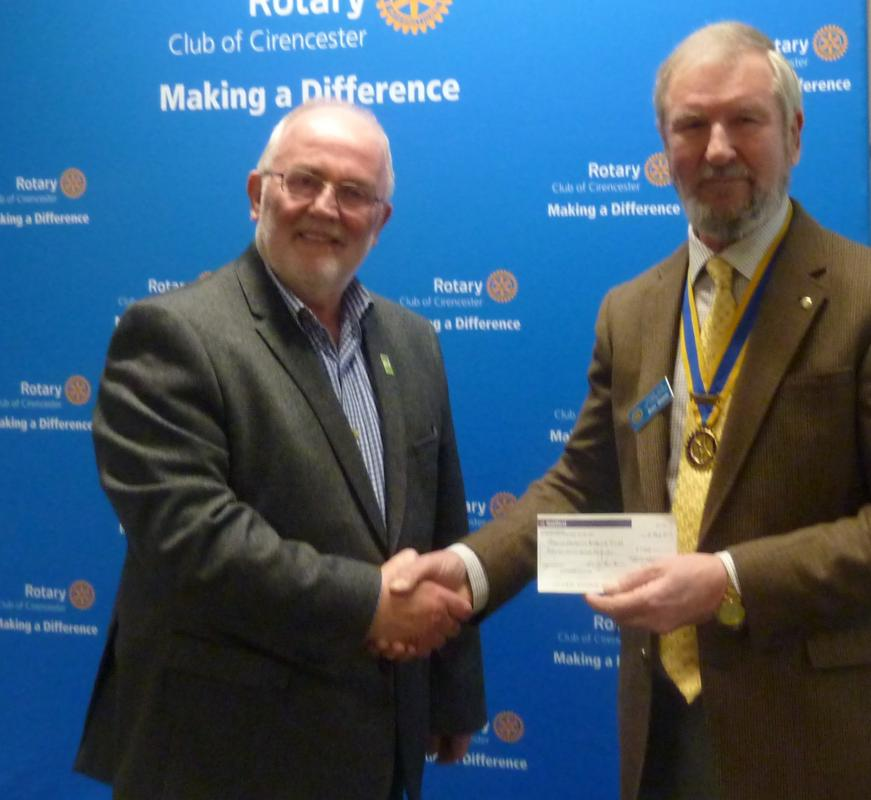 President Brian Skarda presents cheque to the Secretary of GAT, Steve Morton