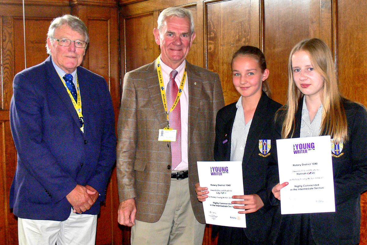 Young Writer - subject 'Reflections' - Lily and Hannah receive their winners' certificates