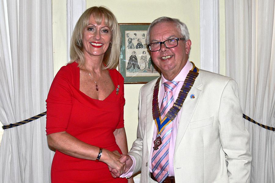 Club Handover at Hemswell Cliff - President Michael is congratulated by Past President Julie.