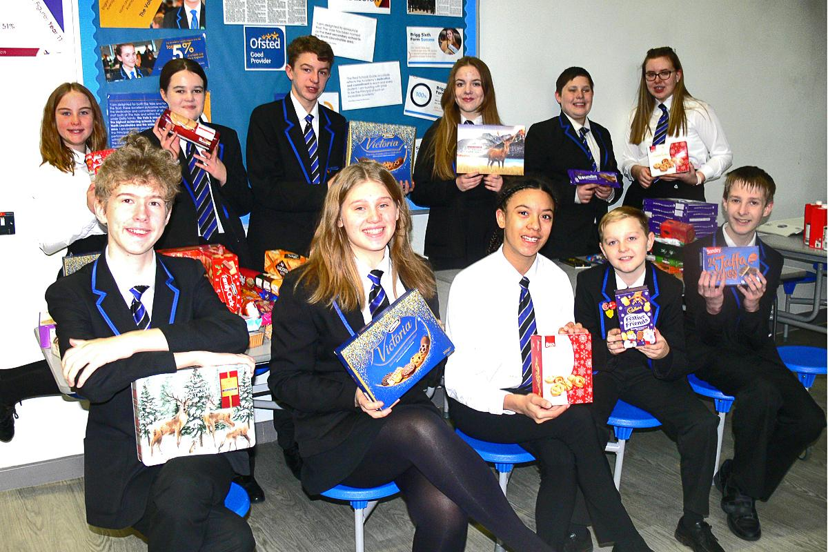 Christmas Hampers for those in need at Christmas - Students from the Vale Academy, Brigg, getting ready to pack parcels.