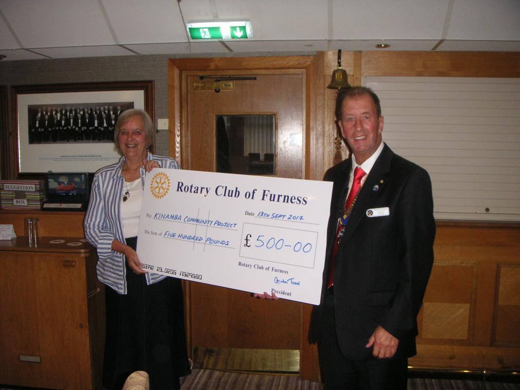 Meg Fletcher from the KINAMBA Project - Host Peter Gardner - President Gordon presents cheque