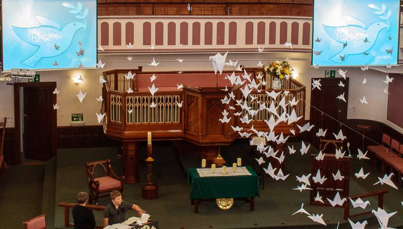 UN World Peace Day Service Sunday 21st September 2014. - Two doves the symbols of peace together with paper cranes in memory of the Japanese girl Sadako.