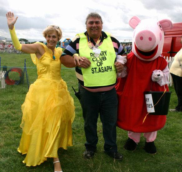 St Asaph country Fayre 2013 - President Mark Kane,  Rotarian Kate Bateman and Peppa pig celebrate a successful fayre day.