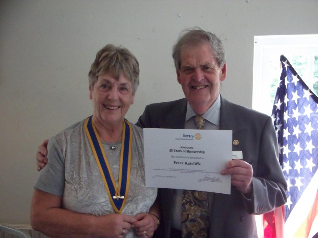 Wigan Rotary Club acknowledges Fifty Years of Service - President Gwyneth presents Peter with his certificate