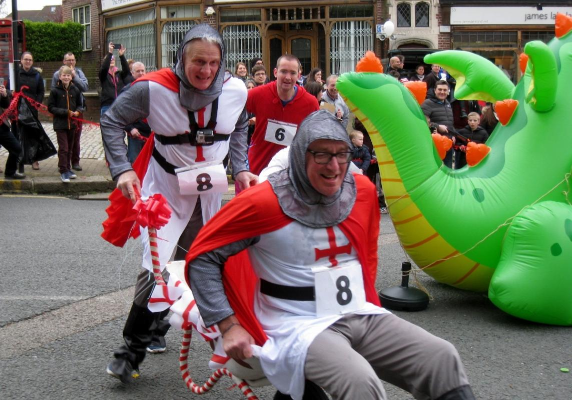 Wheelbarrow racers dressed for the occasion