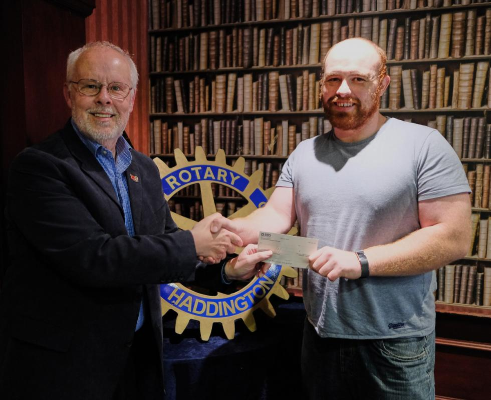 Mark Coull receives a cheque from Vice-President Malcolm Collins