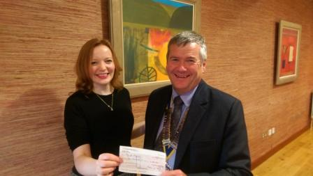 President Graham Dysart presents a Cheque to Anna MacDonald of Play for Progress