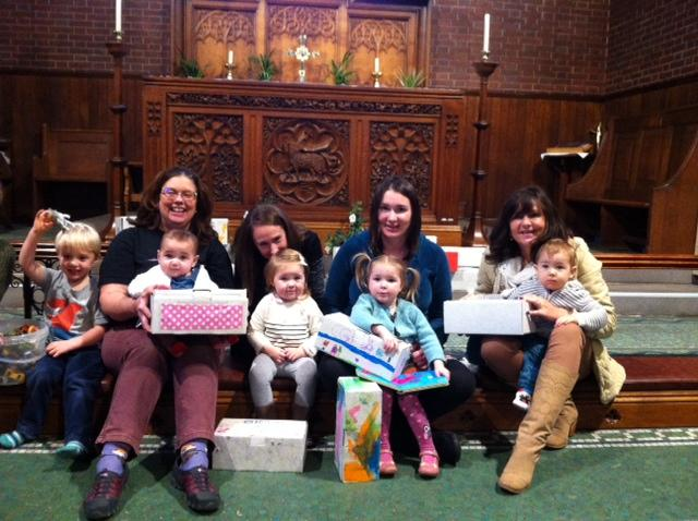 Members of Praise and Play with their filled shoe boxes
