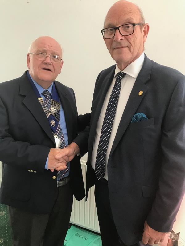 Photograph shows Mervyn with his chain of office thanking retiring President John Wright​