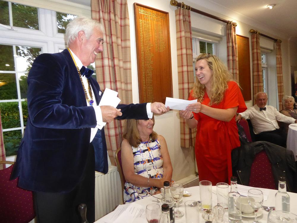 21 June 2018, President's Dinner.  - President Paul Fry presents Jessica Oliver, of the charity Step by Step, with a cheque for £4000 towards their work amongst disadvantaged young people.