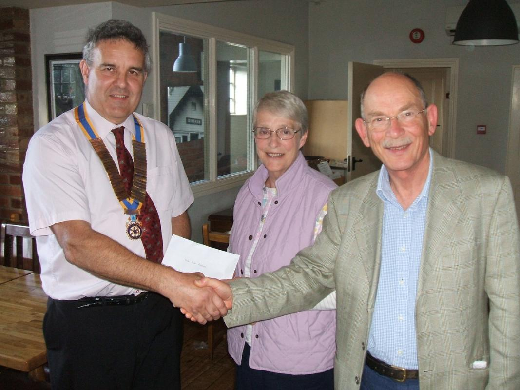 Presentation and Presidential Handover - Outgoing President Richard presents a cheque for £500 to First Responders.