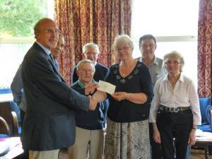 Rotarian Vernon Heritage presents a cheque to the Friends of Bailey Park