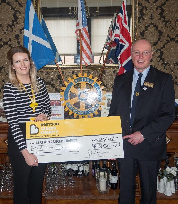 Greenock Rotary Coffee Morning benefits Beatson Cancer Charity  - President Elect Ron Gray presented the cheque to Jen Lindsay