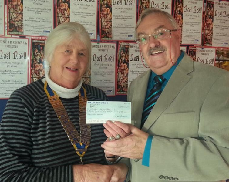 Grahame Jackson presents the cheque to President Judy Greenwood