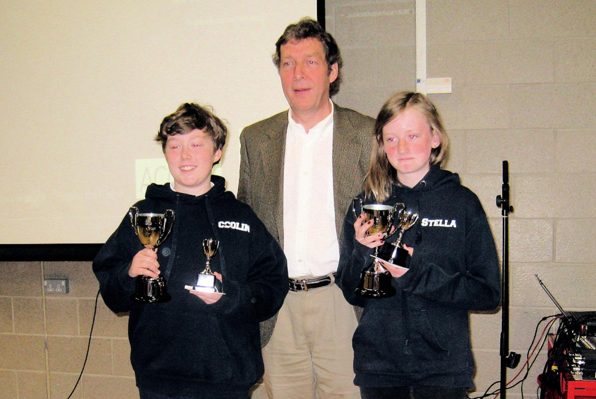 Colin (left) and Stella were the popular winners of the 2018 Hillhead Primary School's Citizenship awards.  They are with Club President Trevor Graham.