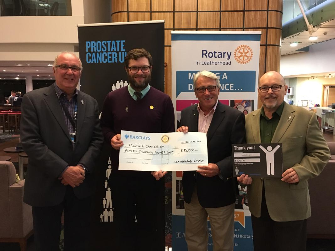 Gary Zabel (third from left), Immediate Past President of Leatherhead Rotary Club, presenting a cheque for £15,000 to Jack Bacon from Prostate Cancer UK, together with local Prostate Cancer UK supporters, Chris Eglinton and Andy Crompton.