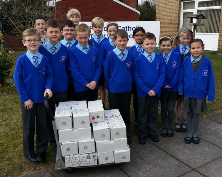 Pupils from St Patrick's Primary School fill 58 shoeboxes for International Aid Trust for Lent.