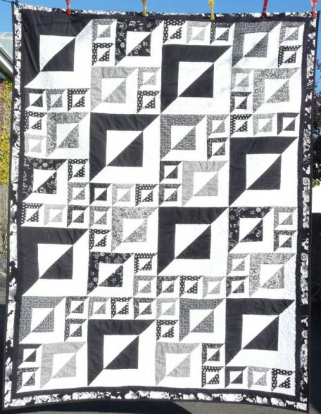This beautiful handmade quilt is being raffled for 'End Polio Now' and other Rotary charities
