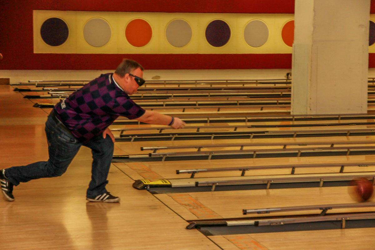 Bowling with a blindfold.