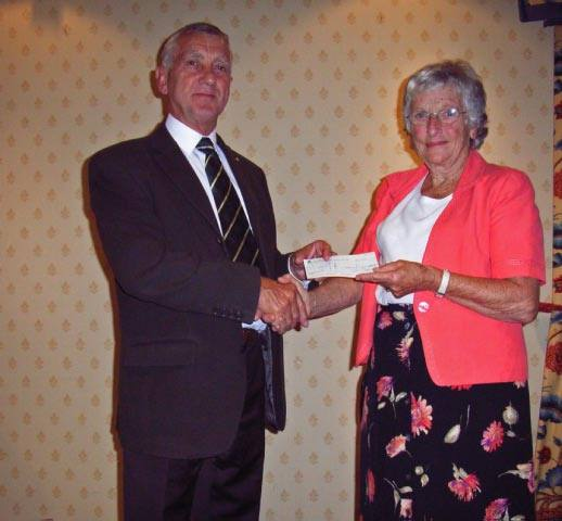 International Chairman Colin Brown presents cheque to Judy Lindgren for Msambweni Youth Group