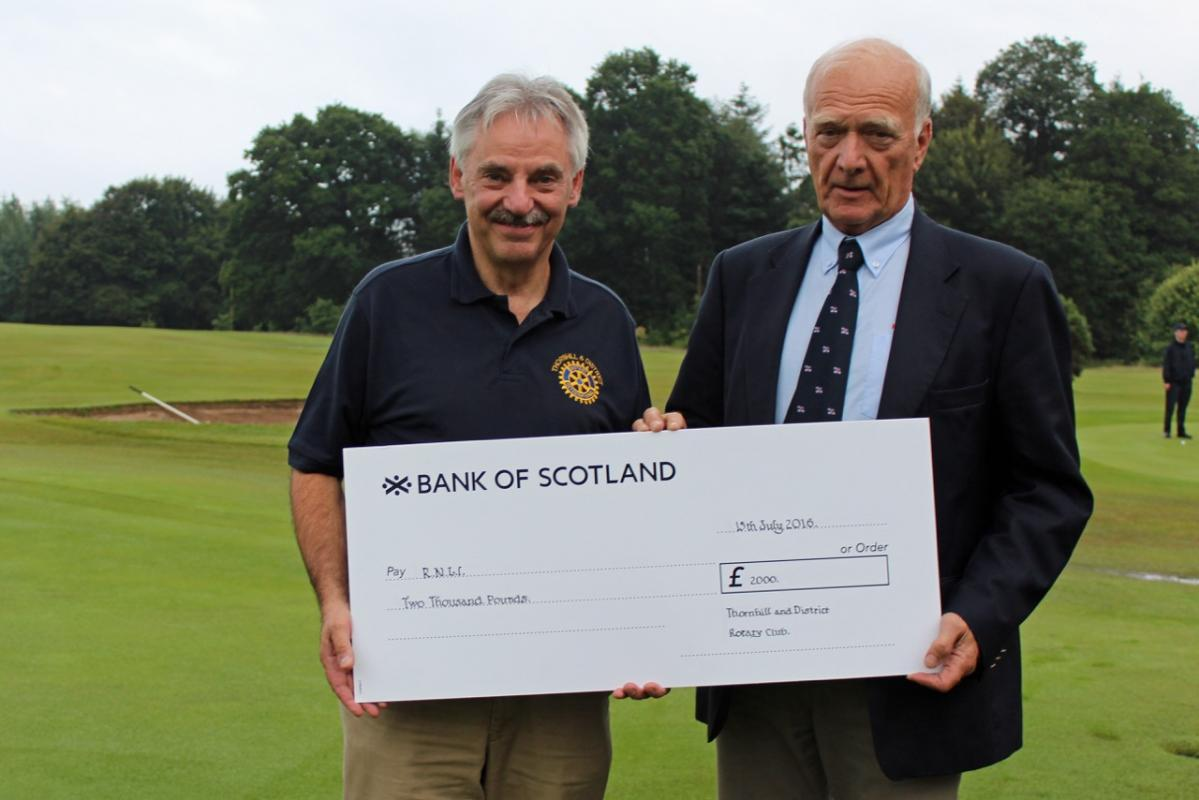 Picture shows Jim Prentice Chairman of Kippford RNLI receiving the cheque from Thornhill Rotary President Ian Morrison
