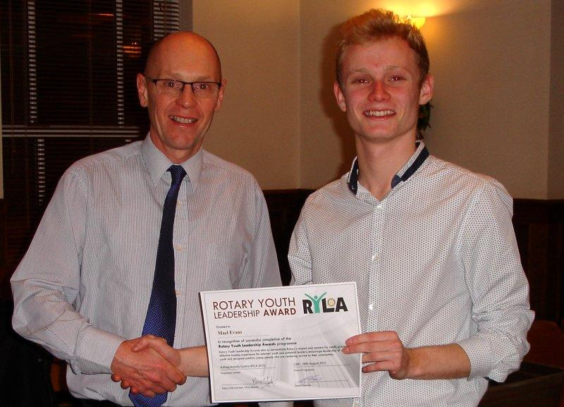 Sponsored student Mael Evans receives his certificate from Ysgol y Berwyn headmaster Andrew Roberts for successfully completing the RYLA Course at Arthog.