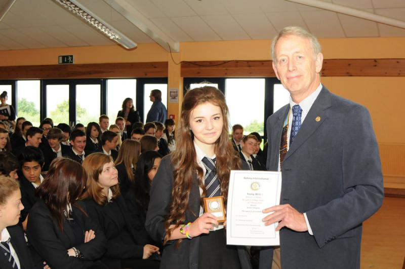 Immediate Past President Nigel Vince presenting Daniella Pink with the Young Writer Award, (Senior Section), during Year Ten Assembly at Ilfracombe Academy on 20th May 2014