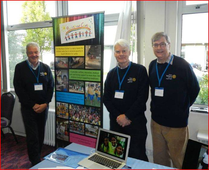 District Conference 2014 - President John Harrison with Peter Tasker and Alan Haines in the excellent priory pullovers manning a display about the Rainbow Centre project