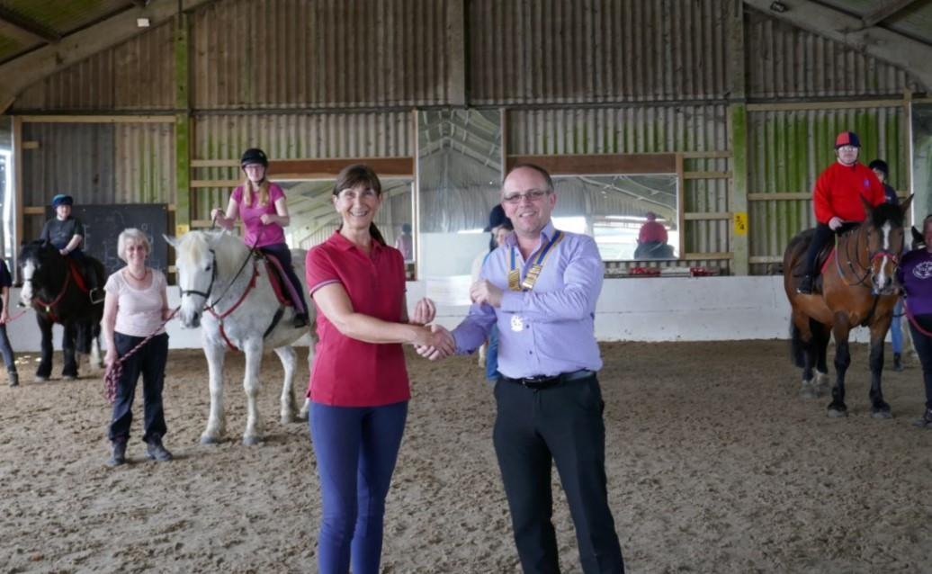 President Carl Watson presents Julie Mace, Secretary of Rawreth RDA, with a cheque for £250