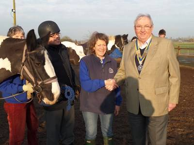 The picture shows Clive Brown, President of Danetre Rotary Club, presenting a cheque to Liz Kenworthy-Browne, RDA Organiser.