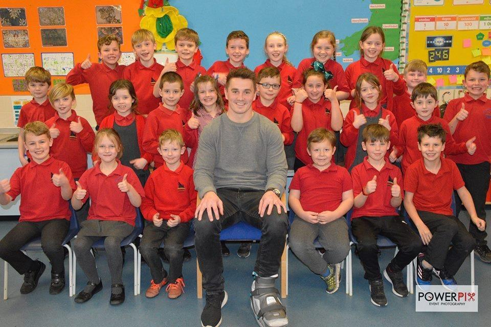 Narberth Junior School 'Rotakids' Club members are pictured with rugby ace Jonathan 'Foxy' Davies