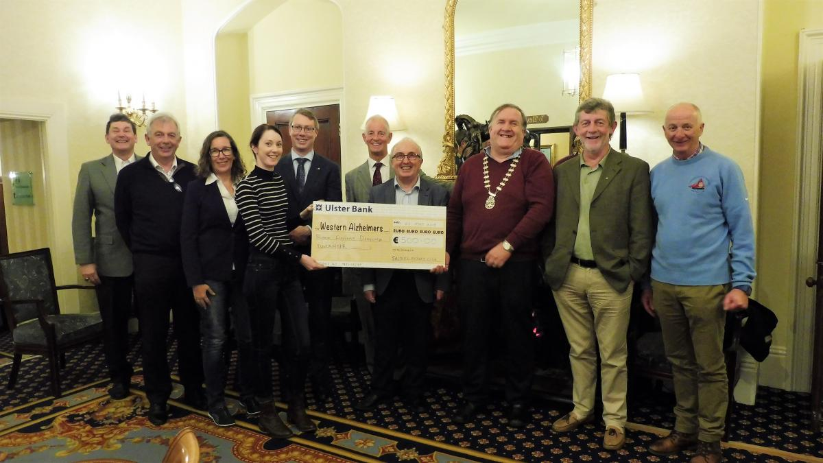 Rotarians presenting cheque to Western Alzheimer's