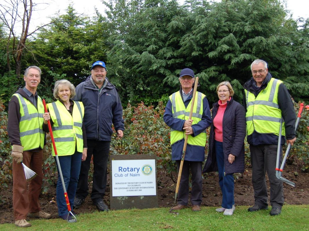 Community & Vocational - Rotarians and Friends tending the Rotary Rosebed on the A96