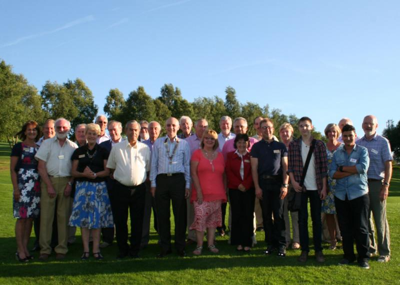 Local Rotarians Enjoying the Early Evening Sunshine.