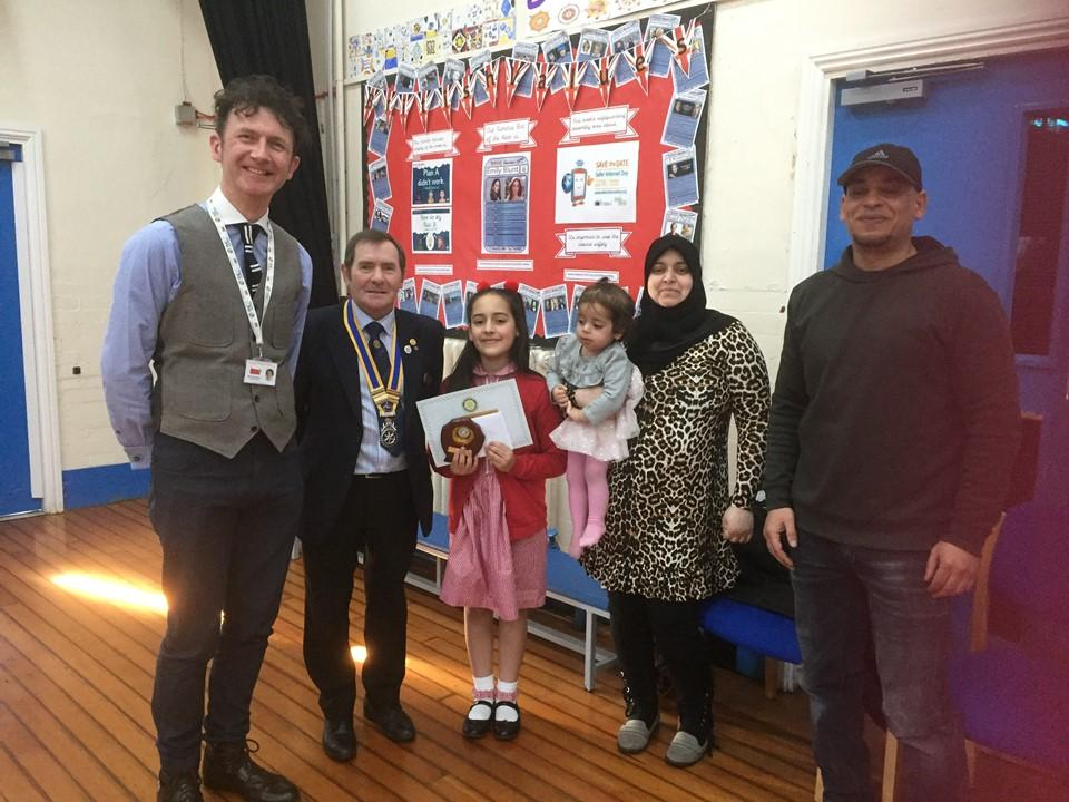 Winner of 2018/19 Hull Primary Schools Writing Competition Kawther Yasir, with her family and the Headteacher of Stepney Primary School