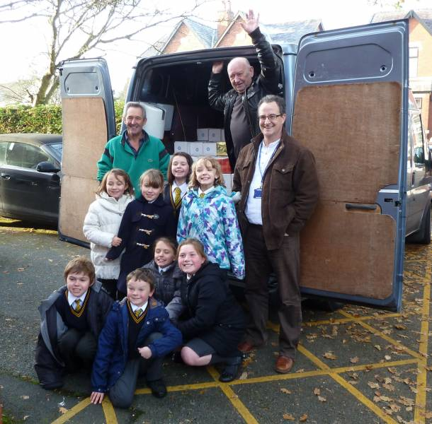 Children and staff of Churchtown Primary School Southport with Rotarians and a van load of shoeboxes!