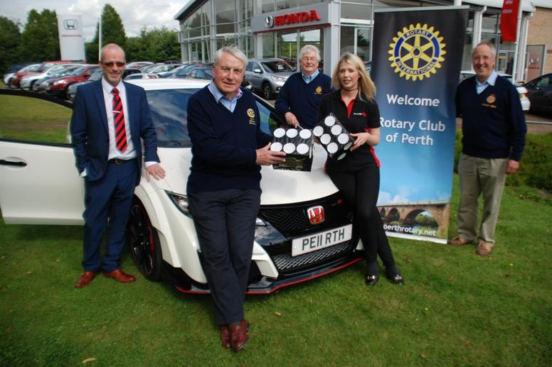 Rotary Fayre - Rotary members inspecting the super Honda type R sports car which features in the Win-a-Car competition at Perth Rotary Club's Charity Fayre in Perth High Street on Saturday 29 August