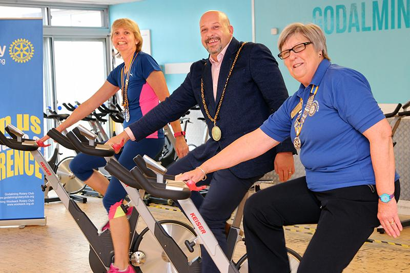 A CYCLATHON in Godalming - Town Mayor, Simon Thornton, joins the two Rotary Presidents Joani and Heather