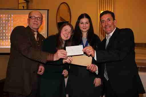 President of The Rotary Club of Southport links with Paul Howells and girls from KGV Interact Club