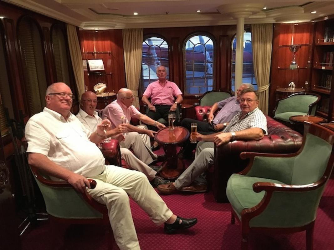 Rotary Club members meeting on board