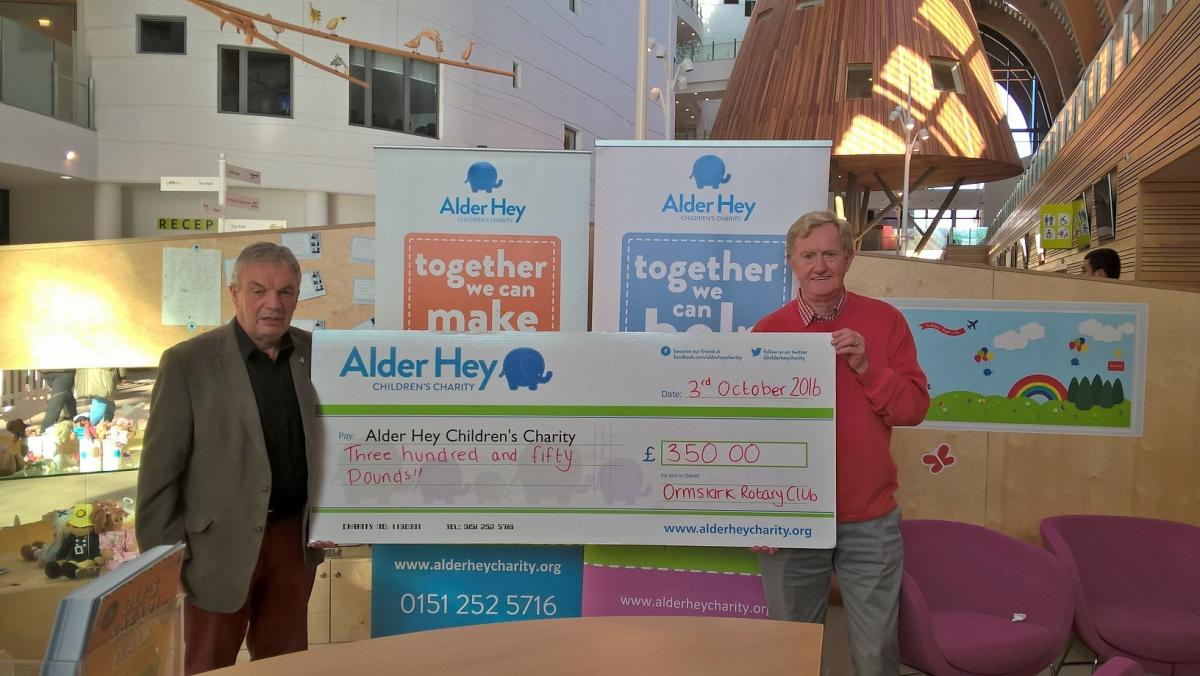 Past President Paul Silcock and Vice President Roger Forster present the cheque to Alder Hey