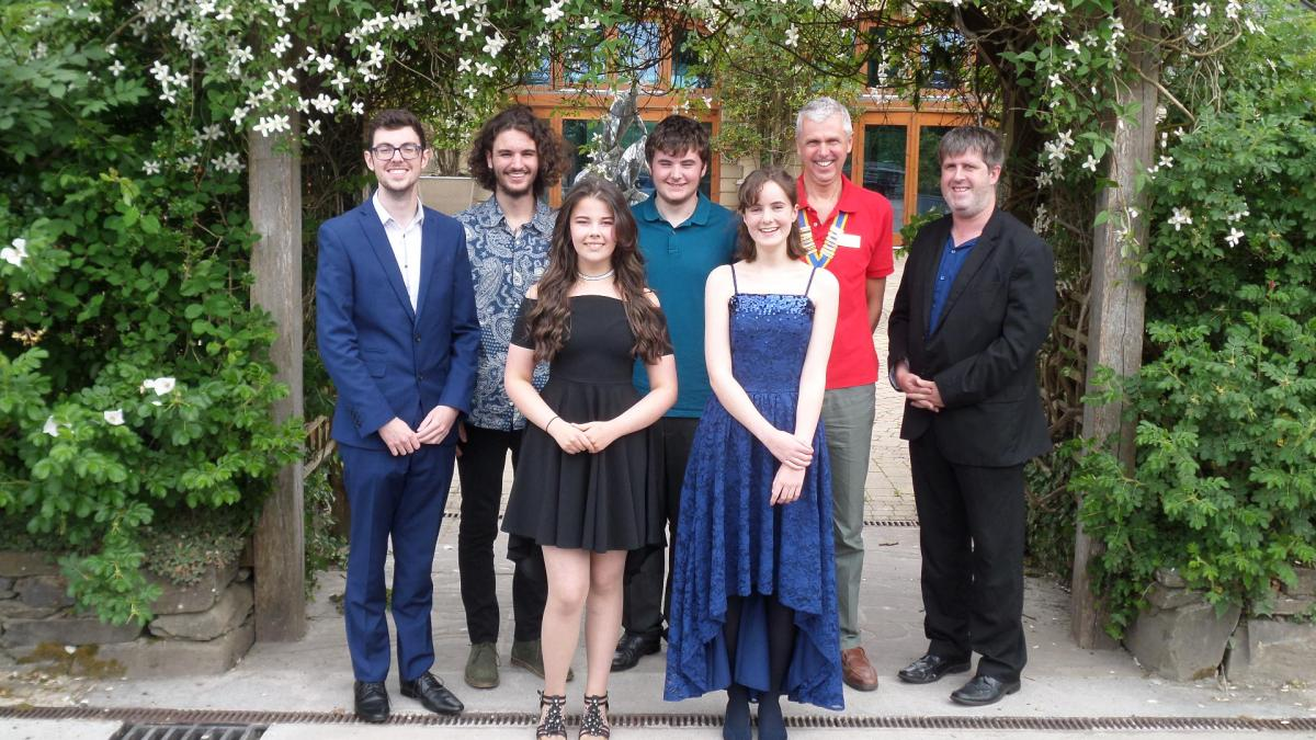 Sounds Fantastic 2018 young musicians are pictured with Rotary Club of Narberth & Whitland President David Haward and accompanist Clive Raymond.