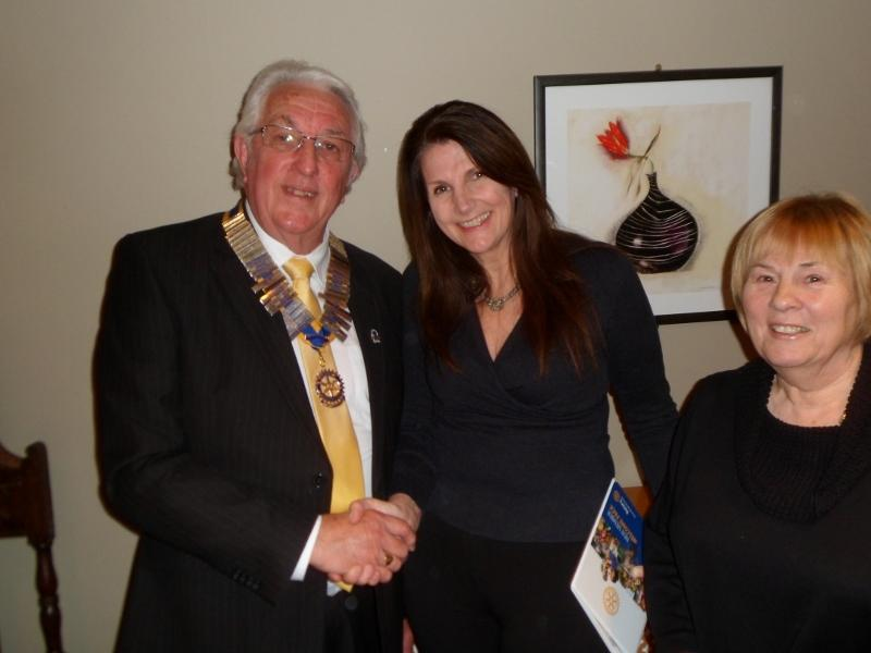 Melanie Evans being welcomed into Rotary by President Ian Kelly along with sponsor Liz Rowe